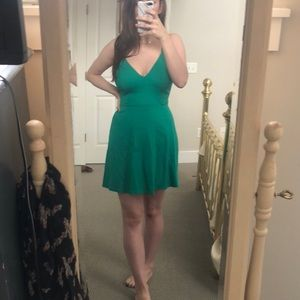 Green sundress with strap details